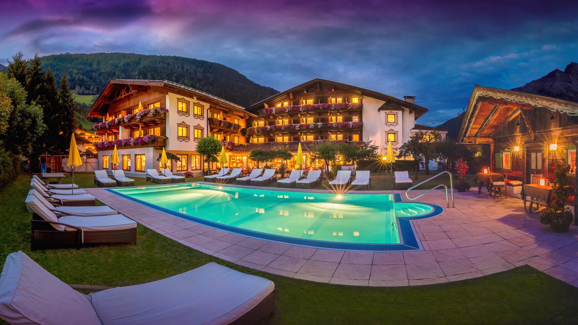 Garden side Alpenhotel Tirolerhof**** Neustift in summer at night