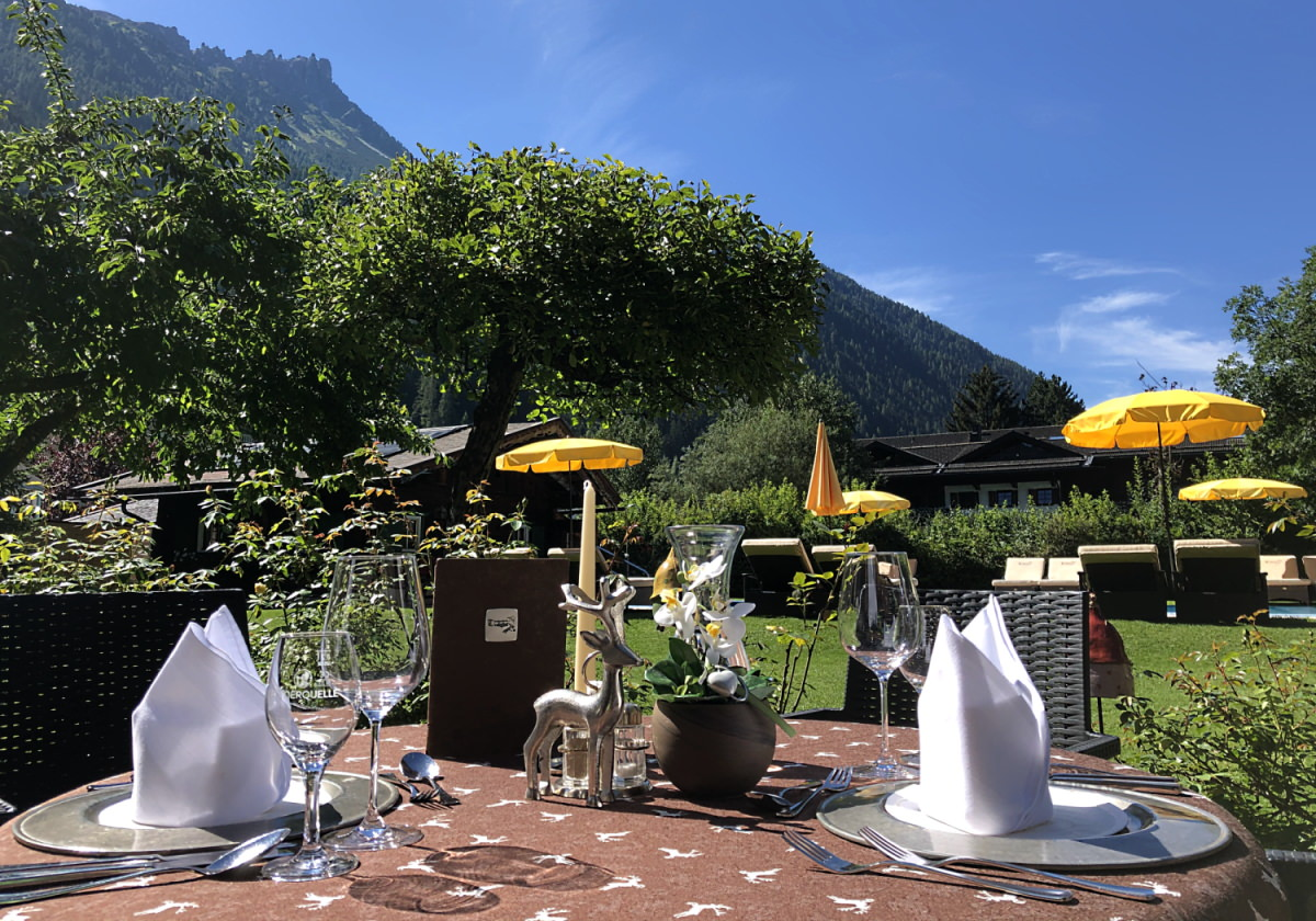 Our sun terrace with a view of the garden and pool